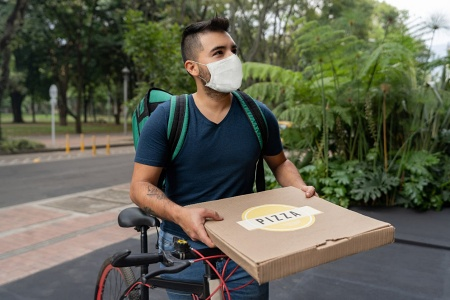 A college student trying to make money by delivering pizzas.